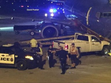 WATCH:  Man Strips Down to Boxers, Scales Airport Fence, Rams Pickup Truck Into Plane