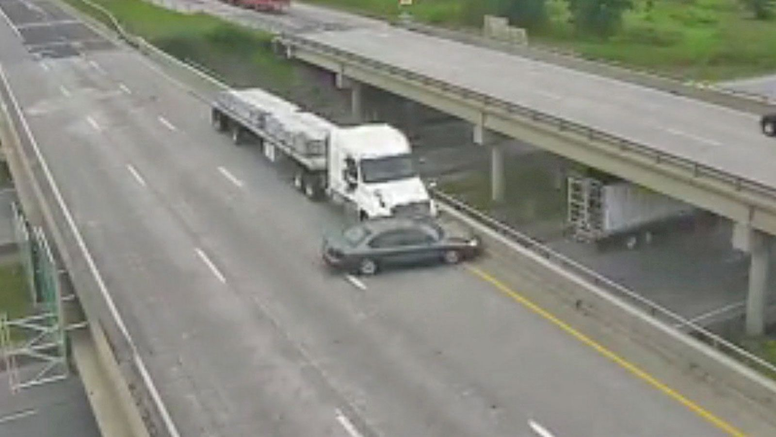 VIDEO: Truck Pushes Car Down Iowa Interstate