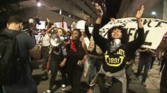 VIDEO: Protesters defied a citywide midnight curfew but remained mostly peaceful.