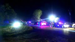 Authorities in Oklahoma have launched a manhunt for a suspect in a double homicide who also allegedly opened fire on two police officers with an AK-47, striking both officers in the legs.