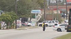 VIDEO: A suspect was taken into custody after a hostage situation stemming from a bank robbery at a Jacksonville, Florida, bank, authorities said this morning.