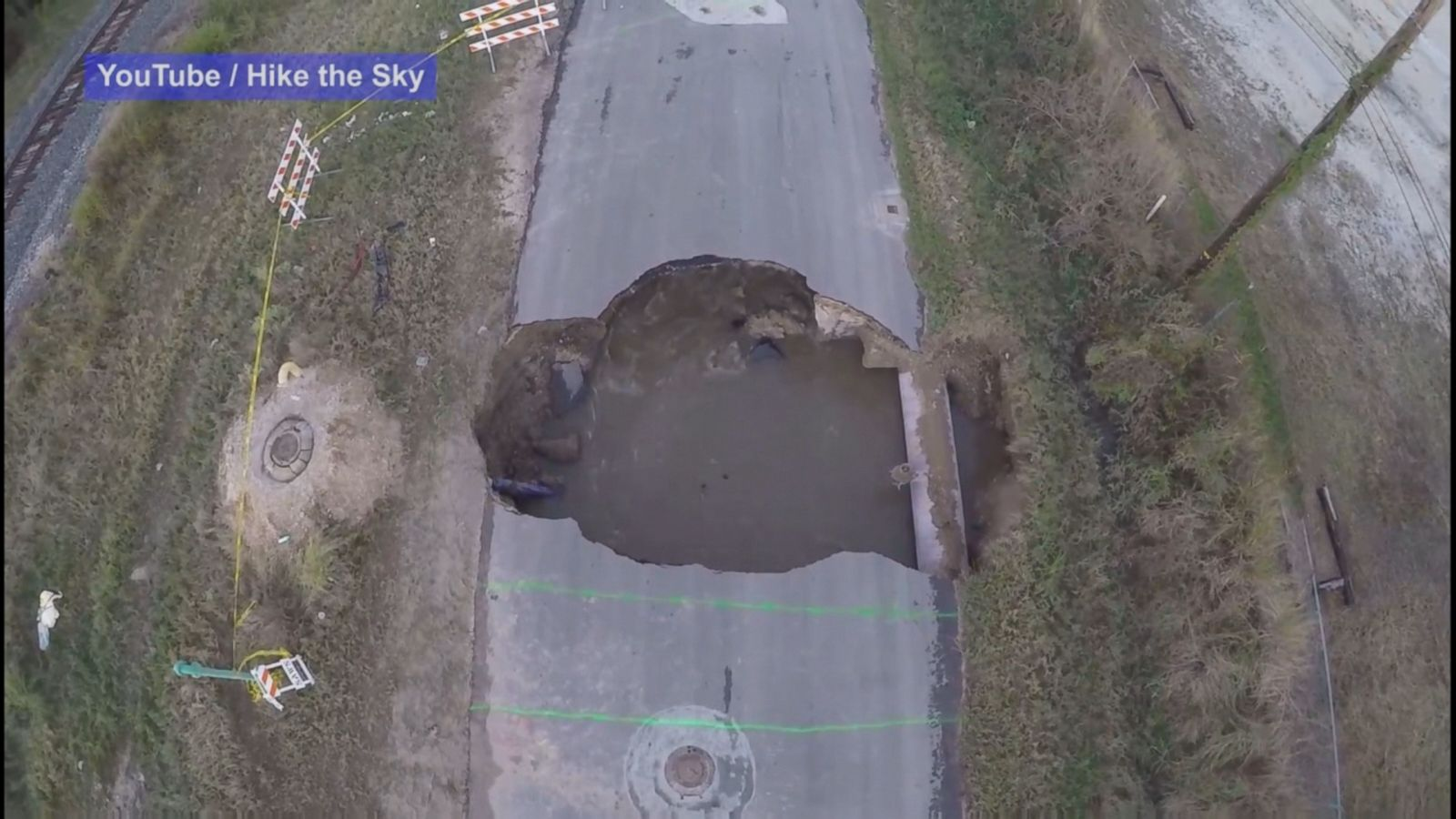 Drone footage captures an aerial view of the sinkhole in San Antonio, Texas that swallowed two cars and claimed the life of a sheriff's deputy.