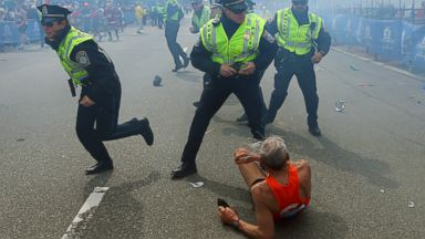 PHOTO: The first explosion knocked down a runner at the finish line of the 117th Boston Marathon.