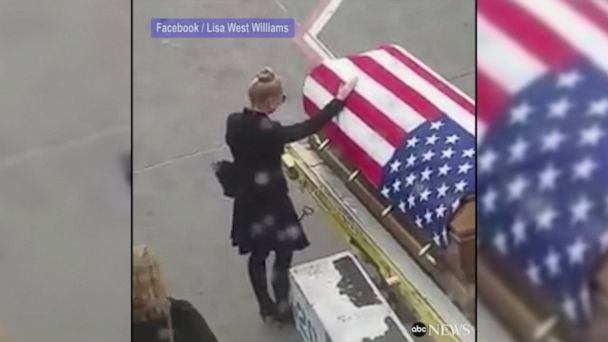 VIDEO: Loved ones pay their respects as casket carrying fallen U.S. Army Green Beret Shawn Thomas is removed from commercial flight on way to be buried at Arlington National Cemetery, as passengers aboard plane are moved to tears.