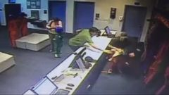 VIDEO: The quick catch by Jesse Tex Leos, an instructor at the Texas business, was captured on surveillance video.