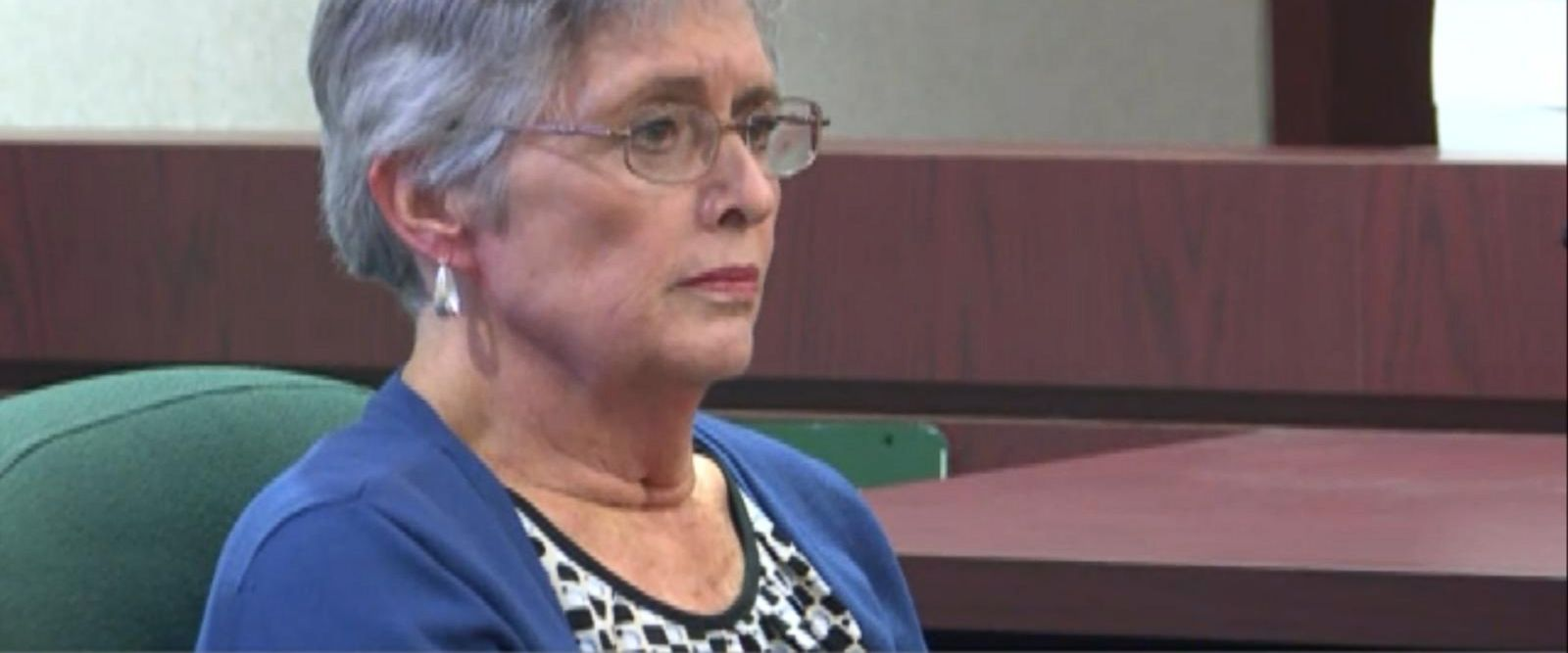 The wife of the former police captain accused of fatally shooting a man in a Florida movie theater testified in court Wednesday in a hearing that will determine if his claim of self-defense meets the criteria under Florida's Stand Your Ground law.