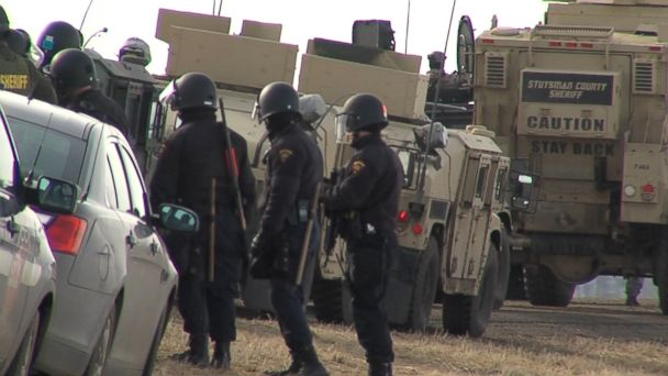 VIDEO: Police clad in full riot gear have entered the main encampment of people protesting the Dakota Access pipeline near Cannonball, North Dakota, where some protesters remained despite state and federal orders to leave.