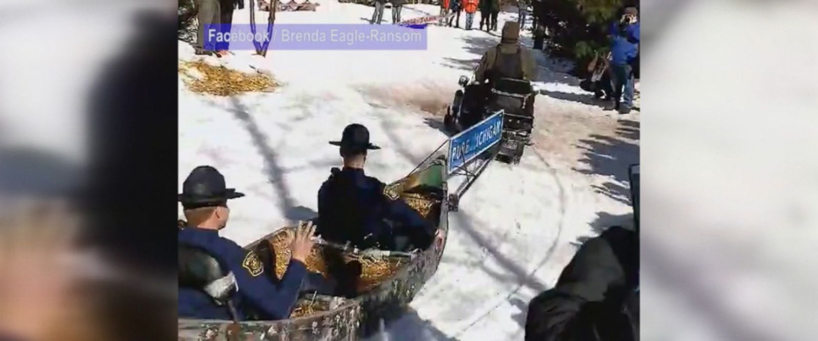 Two Michigan State Troopers took a ride through the snow in a canoe for charity.