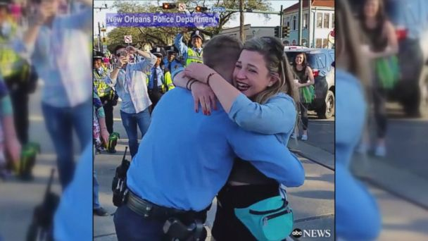 VIDEO: A New Orleans police officer surprised his girlfriend before a Mardi Gras parade by asking her to marry him.