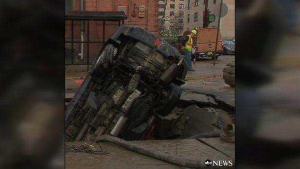 Water main break in Hoboken, New Jersey, creates sinkhole that swallows entire SUV.