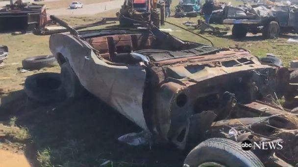 VIDEO: Tornadoes toss junkyard cars onto Missouri highway