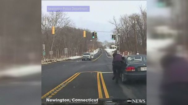 Dashcam video shows Connecticut police officer being dragged by a suspect for 150 yards during a shoplifting investigation before he could free himself. The officer sustained minor injuries as a result.