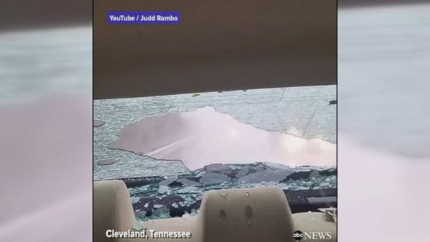 Video shows hail storm breaking the rear windshield of a car in Cleveland, Tennessee.