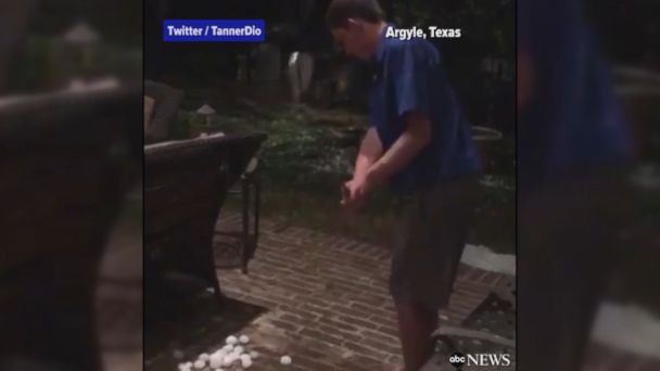 VIDEO: Young man works on his short game using the golf ball-sized hail that rained down on parts of north Texas.