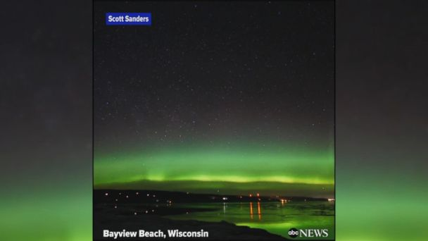 VIDEO: Stunning timelapse video shows the northern lights shimmering over Bayview Beach in Wisconsin.