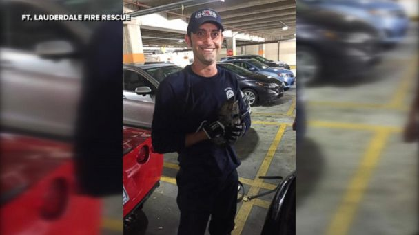 Firefighter Eric Fillyaw helped rescue a kitten from the engine of a 2016 Porsche Cayenne in the Galleria Mall parking lot in Fort Lauderdale, Florida on April 13, 2017.