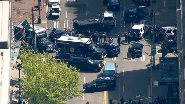 Two Seattle police officers were shot Thursday while responding to a robbery, according to the city's police department.