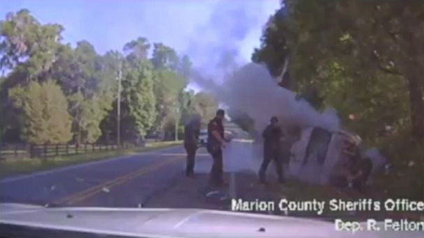 VIDEO: Dash cam video from the Marion County Sheriff's Office shows four sheriff's deputies as they extract the man from the overturned van and extinguish the fire.