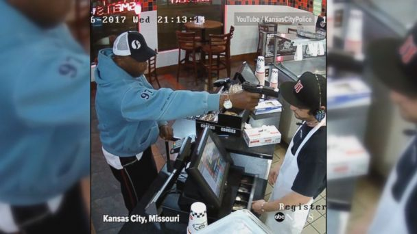 VIDEO: CCTV footage shows a Jimmy John's sandwich shop employee calmly reacting to being robbed at gunpoint in Kansas City. Police are still looking for the suspect.