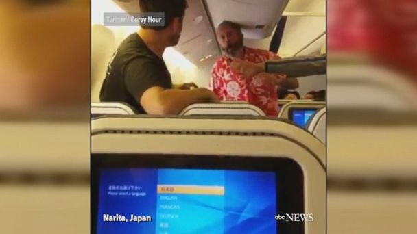 Video shows fight break out between two men on an All Nippon Airways flight bound for Los Angeles. One of the men was subsequently arrested, airline says.