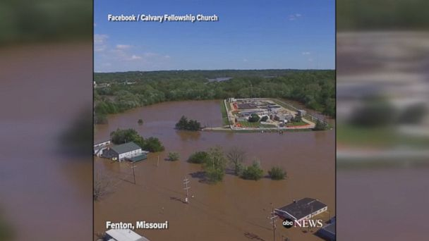 Drone footage shows widespread flooding in Fenton, Missouri as high waters continue to ravage parts of Missouri and Arkansas.