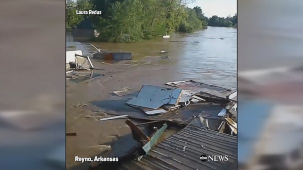 Cabin gets swept away in raging floodwaters, crashes into a bridge and gets destroyed.