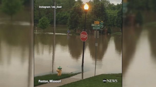 VIDEO: Young girl braves flooded streets of Fenton, Missouri on her bicycle as heavy rains shut down hundreds of roads.