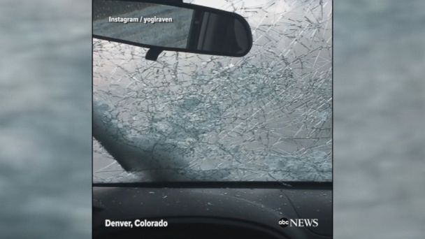 Video shows car windshields cracking as a heavy hailstorm ravages Denver, Colorado, including the Colorado Rockies baseball stadium.