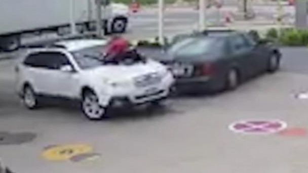 VIDEO:  Surveillance video shows woman trying to stop car theft