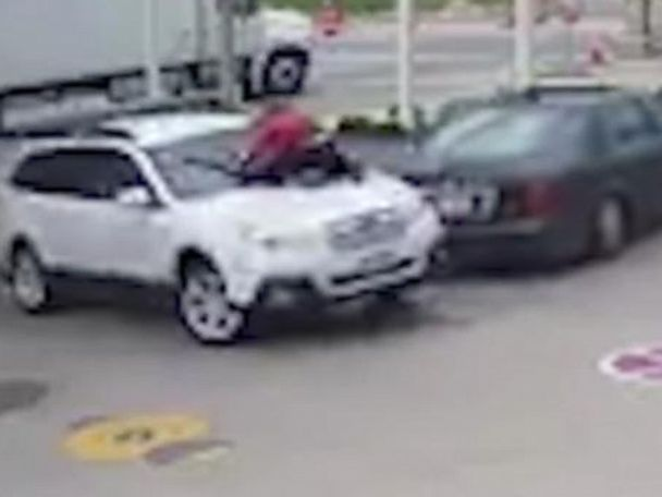 WATCH:  Surveillance video shows woman trying to stop car theft