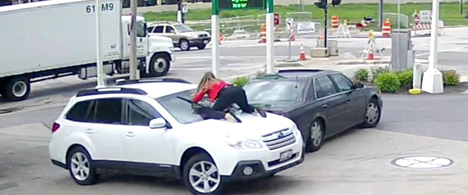 Melissa Smith said when thieves tried to steal her car at the gas station in Wisconsin on Tuesday, she fought back, jumping on the hood.