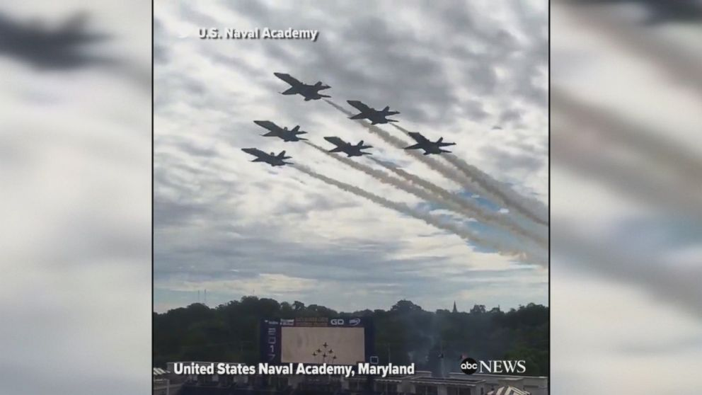 U.S. Navy Blue Angels fly over the United States Naval Academy graduation ceremony in Annapolis, Maryland.
