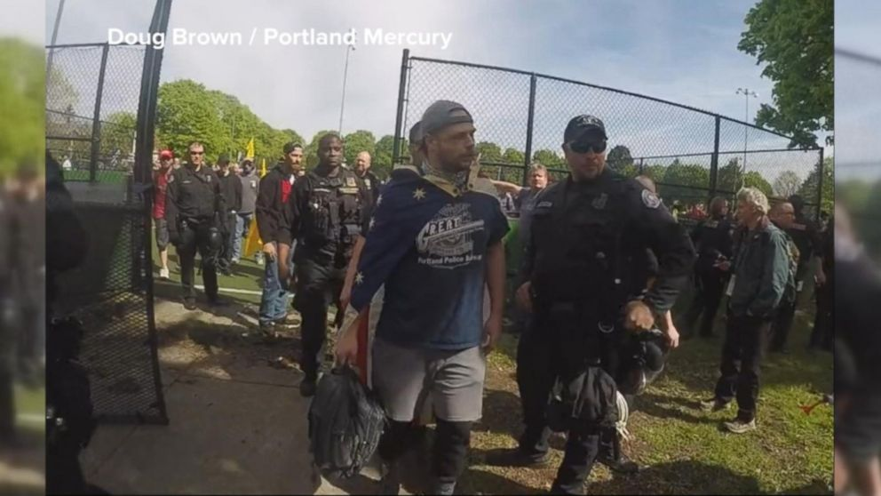 VIDEO: Man who appears to be suspect in fatal stabbings attended April rally