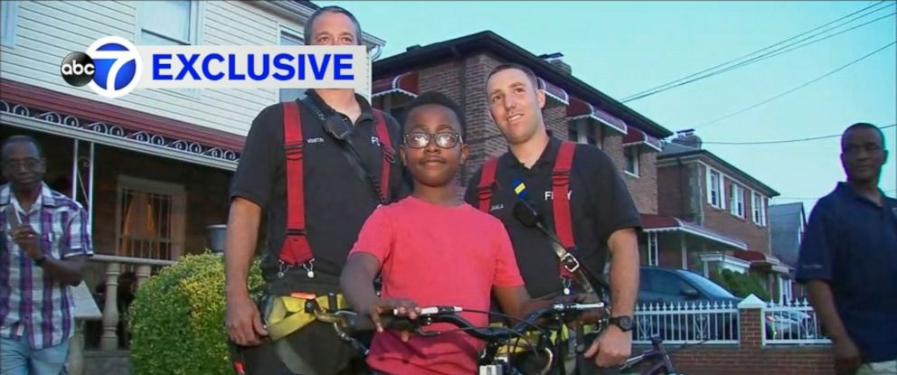 VIDEO: Tyreis Morris, 9, was presented with a new bicycle after being rescued.