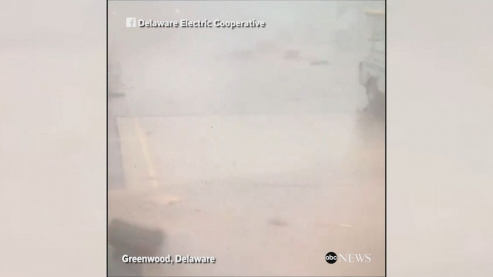 High winds from a severe thunderstorm whip up debris at a plant in Delaware.