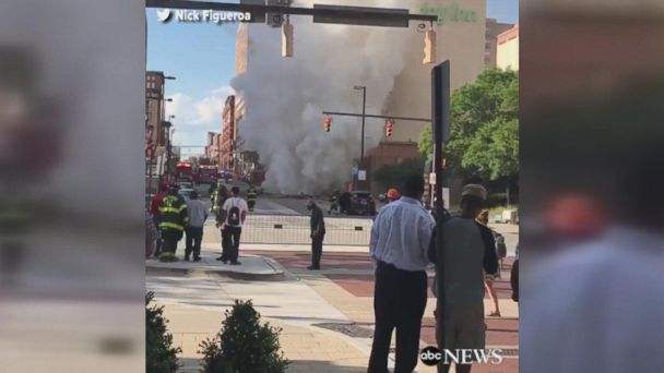 Officials say two people were injured when an underground steam pipe exploded, blowing a huge hole in a downtown street.