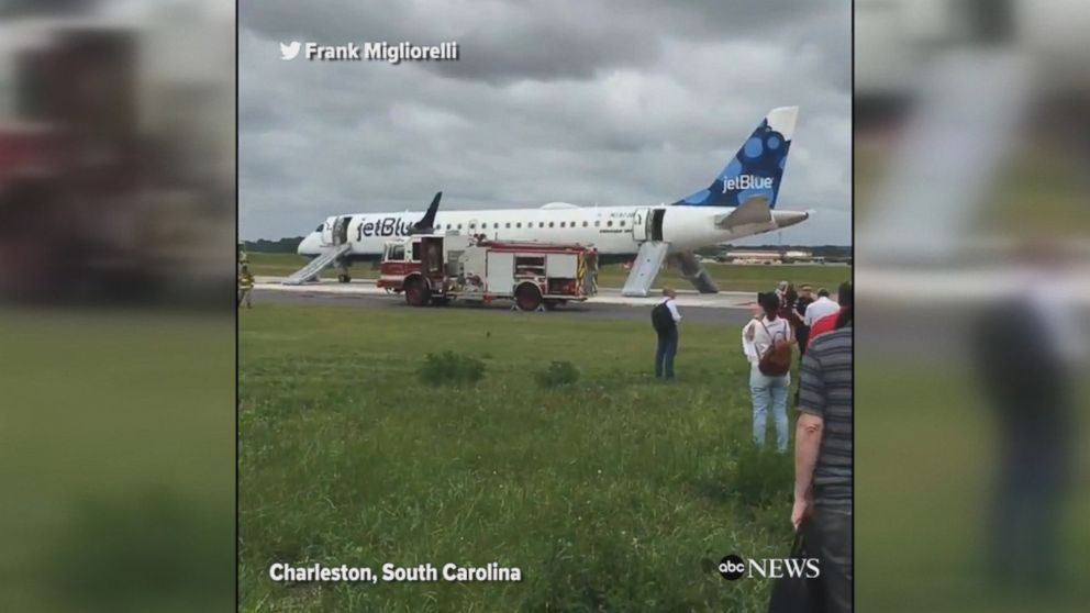 Passengers evacuated via emergency slides after a JetBlue flight made an emergency landing in Charleston, South Carolina, amid reports of smoke in the cabin.