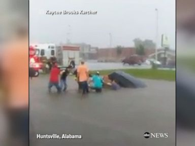 WATCH:  Good Samaritans free driver stuck in flooded car