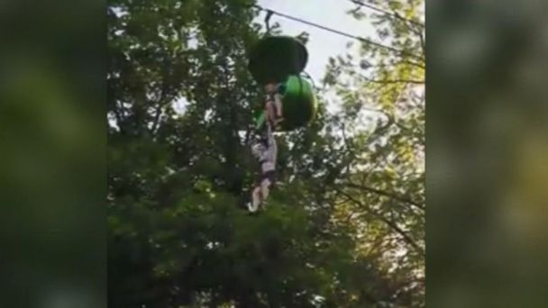 VIDEO: Teen rescued after falling from amusement park ride