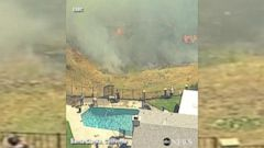 VIDEO: California residents use pool water to battle fire north of LA