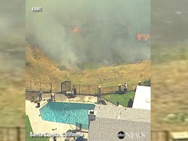 WATCH:  California residents use pool water to battle fire north of LA
