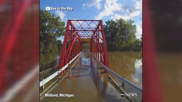 Flooding from the Tittabawassee River in Michigan has washed away possessions and damaged structures.