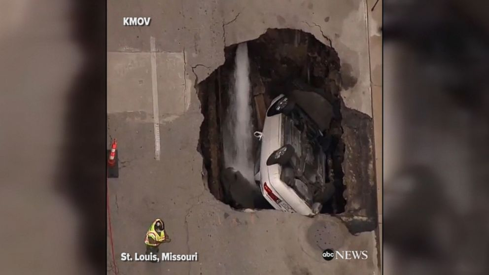 This footage shows an entire car that was swallowed up by a sinkhole in downtown St. Louis, Missouri.