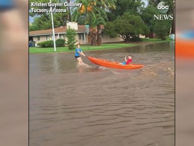 WATCH:  Kayakers take advantage of flooded streets in Arizona