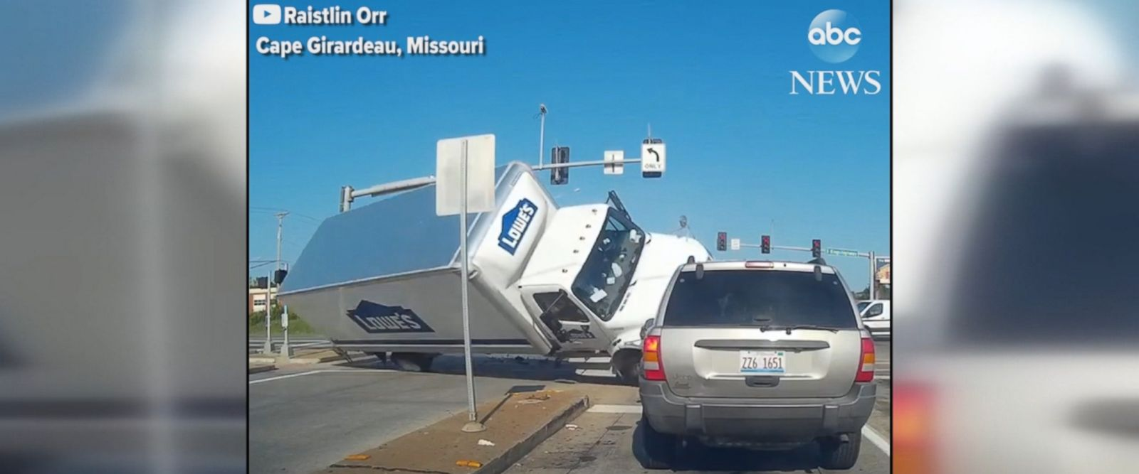 A Lowe's Home Improvement truck apparently ran a red light in Missouri, colliding with a car and flipping over in the intersection.