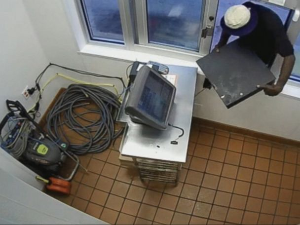 WATCH:  Man grabs drive-thru cash register through window