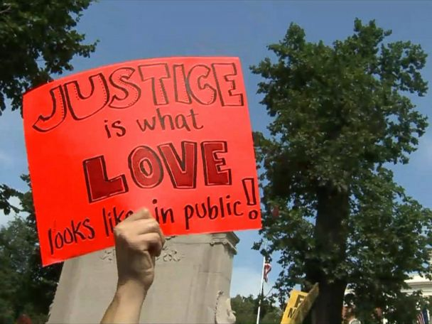 WATCH:  The signs held up by the counterprotesters