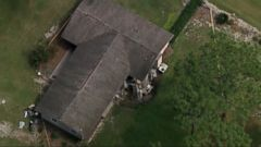 A huge sinkhole opened up in a city northwest of Orlando, Florida, this morning, damaging part of a home.