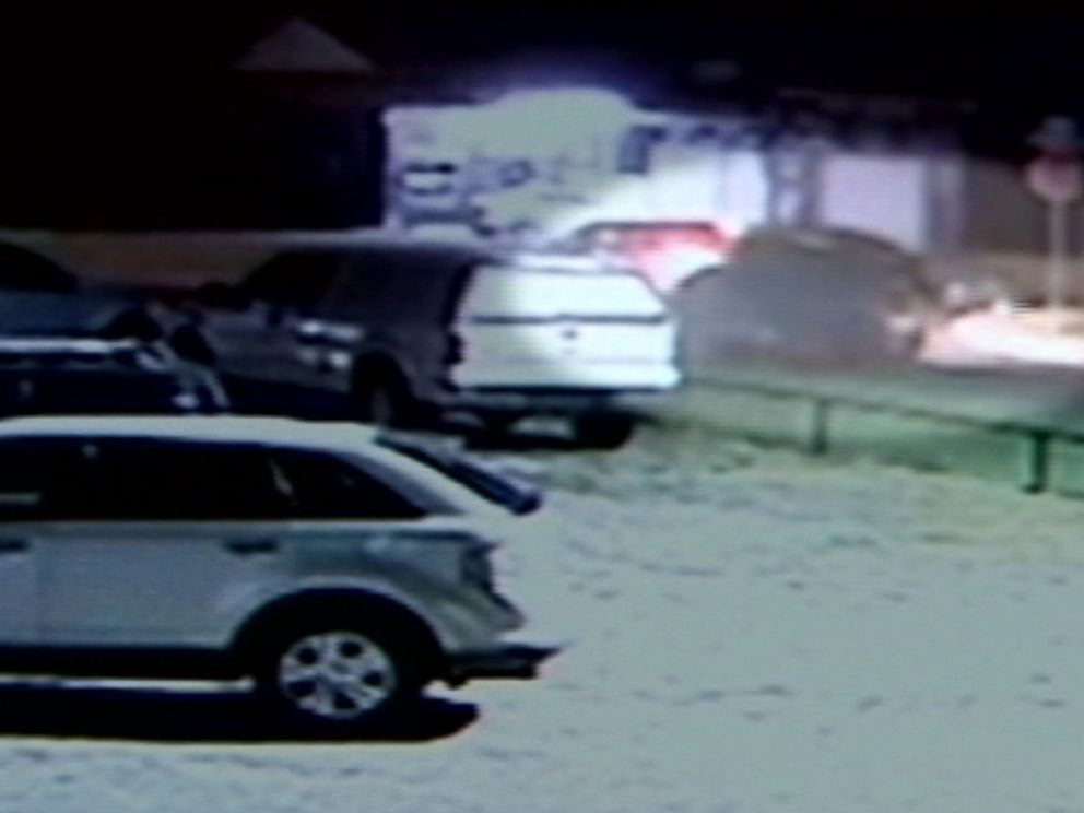 Oklahoma City Police officers pursued the green truck seen in the surveillance recording, leading them to Magdiel Sanchez, who was later shot and killed by authorities.