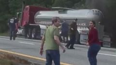 VIDEO: Strangers rush to save couple trapped under burning tanker